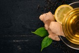 Tea with lemon and ginger. Hot drink On a wooden background. Top view. Copy space. - 187642951