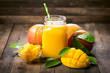 Fresh mango smoothie in the glass - 187649907