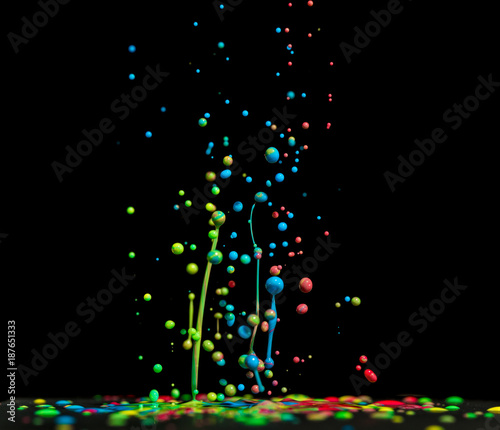 Sticker Jumping drops of paint or ink on a black background. multi-colored abstract shapes. Color splash
