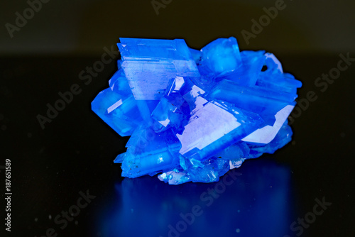 Blue natural crystal mineral on a black background - 187651589