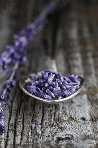 Fotobehang Lavendel Close-up of the spoon with dry lavender.