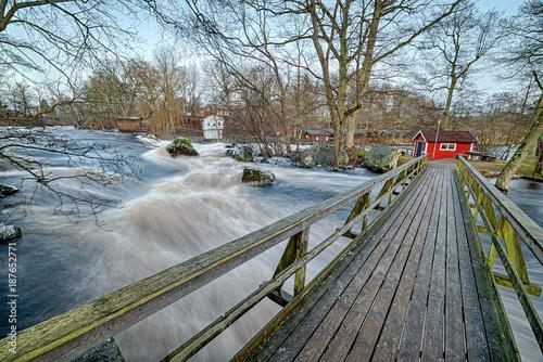 Foto Murales Bridge over Morrum river in January