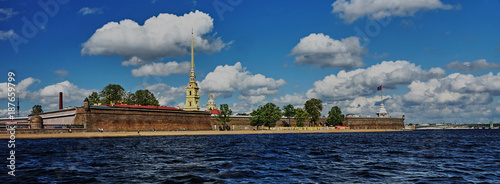 Fotobehang Panoramafoto s Panorama of the Peter and Paul Fortress/View of the Peter and Paul Fortress from the Neva River, Russia, noon, sun in the zenith, water landscape