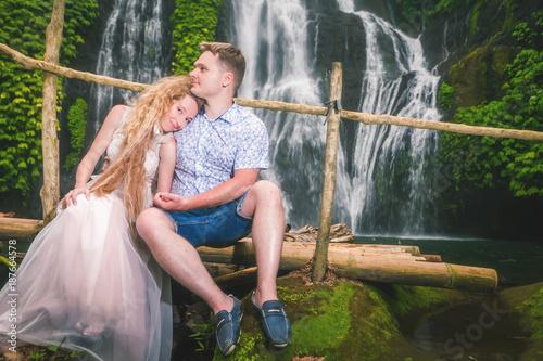 Fotobehang Bali Happy couple travels to waterfall, Indonesia. Bali