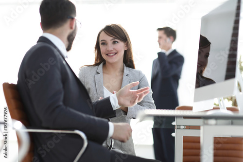 Manager and client talking in the office. - 187677926