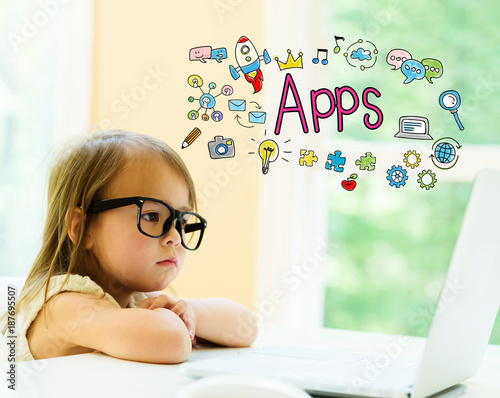 Apps text with little girl using her laptop