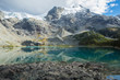 Third lake of Joffre Lakes Provincial Park. Pemberton British Columbia Canada. Sunny and cloudy day with lake reflection.