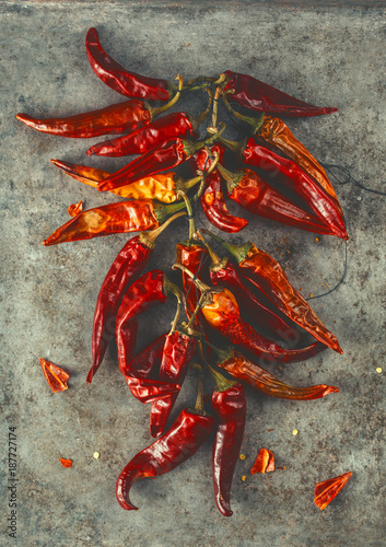 Foto op Canvas Hot chili peppers Dry red hot pepper on an old surface