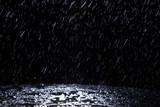 Dark background shot of rain falling - 187729742