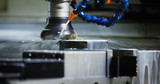 Precision industrial CNC machining of metal detail by mill at factory - 187729972