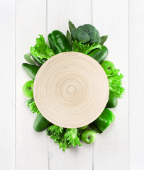 Empty plate with frame of green vegetables