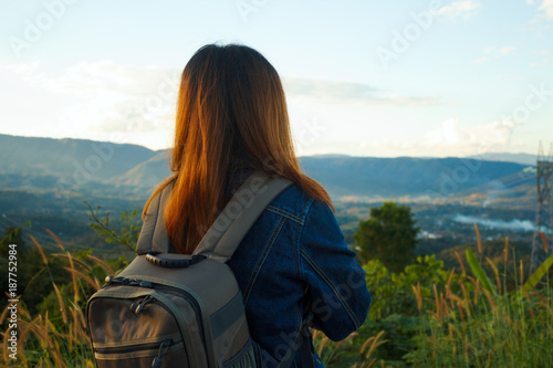 Foto Murales Woman traveler with backpack looking view on peak of mountain