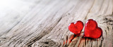 Valentines Day Background Two Red Hearts On Vintage Wooden Table - 187755727