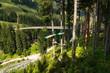 Alpine Golden Gate suspension bridge in Saalbach-Hinterglemm valley, Alps, Austria