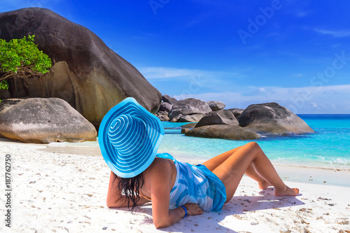 Beautiful woman in blue hat on the tropical beach - 187762750