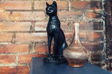 The figure of a black cat