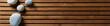 Leinwanddruck Bild - zen pebbles set on design wooden board, top view banner