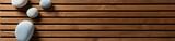 zen pebbles set on design wooden board, top view banner - 187778588