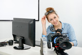 young woman using computer for video editing - 187782575