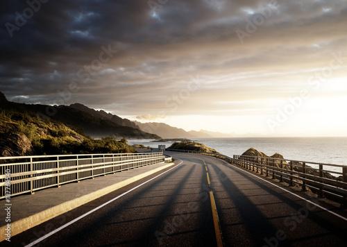 Foto auf Acrylglas See sonnenuntergang road by the sea in sunrise time, Lofoten island, Norway