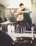Hairdresser doing new haircut - 187792172