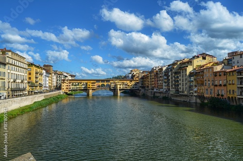Fotobehang Bruggen Florence, Pontevecchio, Tuscany, Italy August 27, 2014 Arno river. Blue sky with soft white summer clouds.