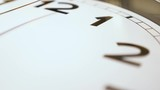 An extreme close up of the sweeping second hand on a typical household wall clock. Shallow depth of field.  - 187828545