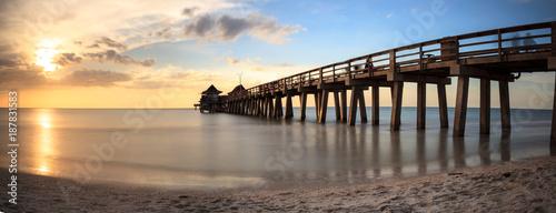 Aluminium Strand Naples Pier on the beach at sunset