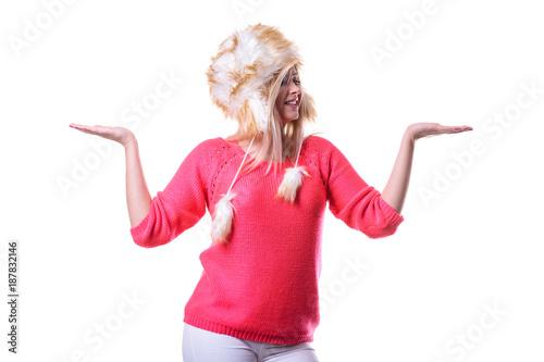 Foto Murales Attractive woman wearing furry winter hat