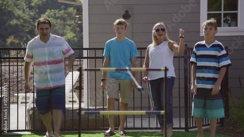 Group of people playing backyard games
