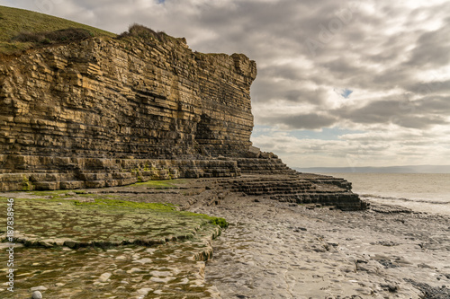 Cliffs on a cloudy day at Monknash Beach in South Glamorgan, Wales, UK