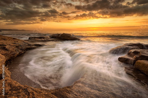 Foto Murales Rocky sunrise / A beautiful view with first rays at a rocky Black Sea coast, Bulgaria