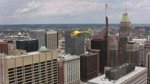Fridge magnet Aerial shot of helicopter flying over Baltimore, Maryland.  Shot with Cineflex and RED Epic-W Helium.