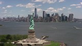 New York City, New York circa-2017, Flying by Statue of Liberty towards Manhattan.  Shot with Cineflex and RED Epic-W Helium.  - 187855537