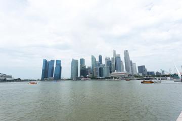modern buildings near water in modern city