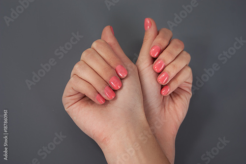 Foto op Canvas Manicure female hands manicure on a black background. studio isolate