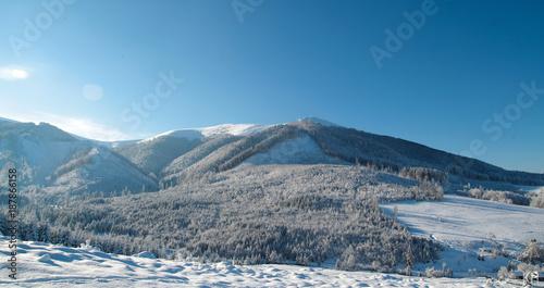Fotobehang Blauwe jeans Massive line of mountains