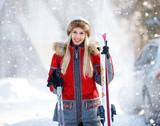 Female skier with skis on mountain
