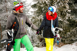 couple snowboarder enjoying outdoors at ski resort in the mountain