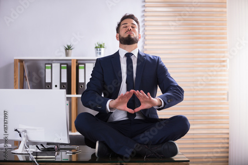 Foto op Aluminium School de yoga Businessman Doing Yoga In Office