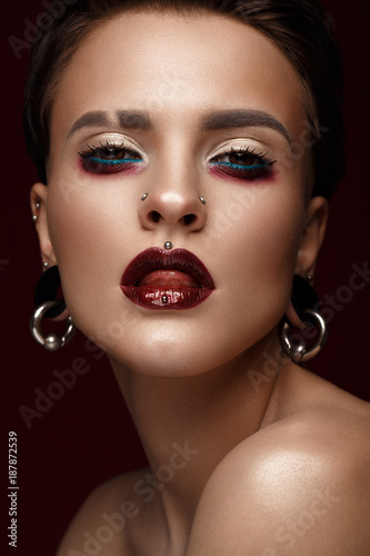 Foto op Aluminium Kasteel A beautiful girl with art creative make-up and earrings on the face. Photos shot in studio