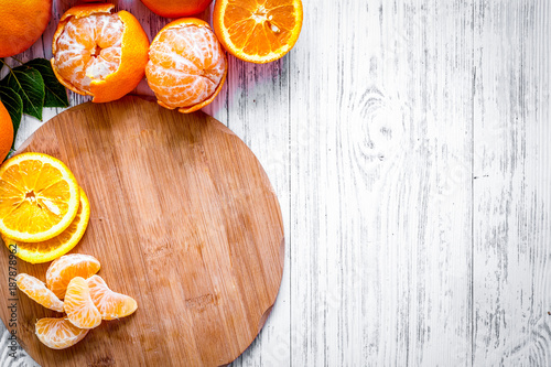 Foto Murales Citrus concept. Oranges and mandarins on wooden table background
