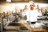 Cook chef in kitchen  - 187879903