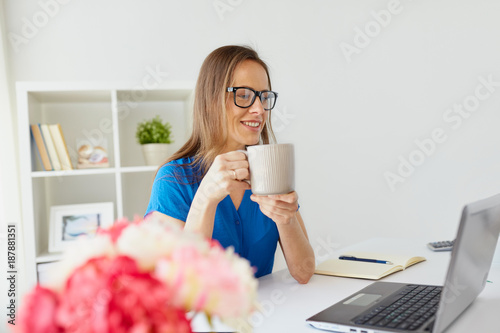 Foto Murales woman with laptop and coffee at home or office