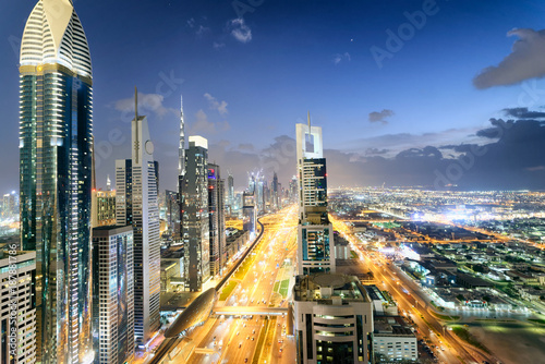 Foto op Plexiglas Dubai Downrtown skyline along Sheikh Zayed Road at night, Dubai