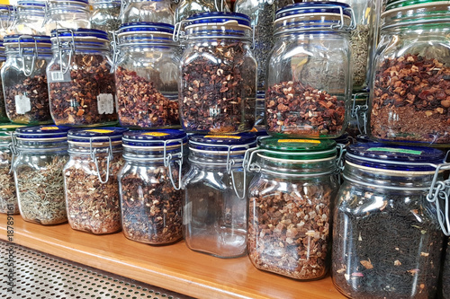 Herbs in Jars on Shelves in a Shop