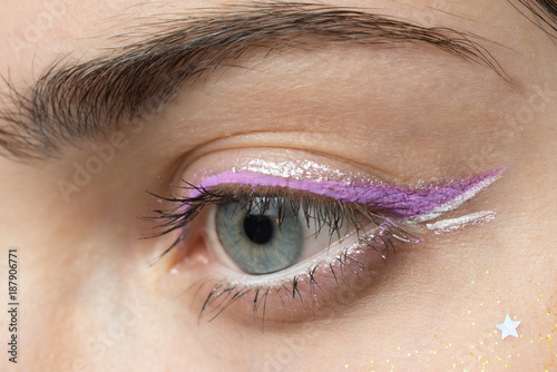 close up woman eye with bright makeup macro shot - 187906771