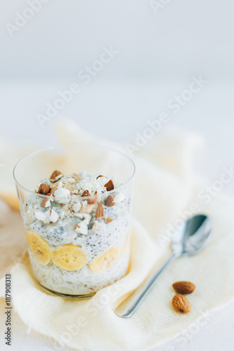 Foto Murales breakfast, oatmeal with banana and almons, chia,   in a glass