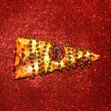 Slice of pizza on red sequins. Fast Food Art Flat lay minimal - 187925502