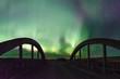 Aurora Borealis Northern Lights over the Rush Lake Creek Bridge near Rush Lake, Saskatchewan, Canada